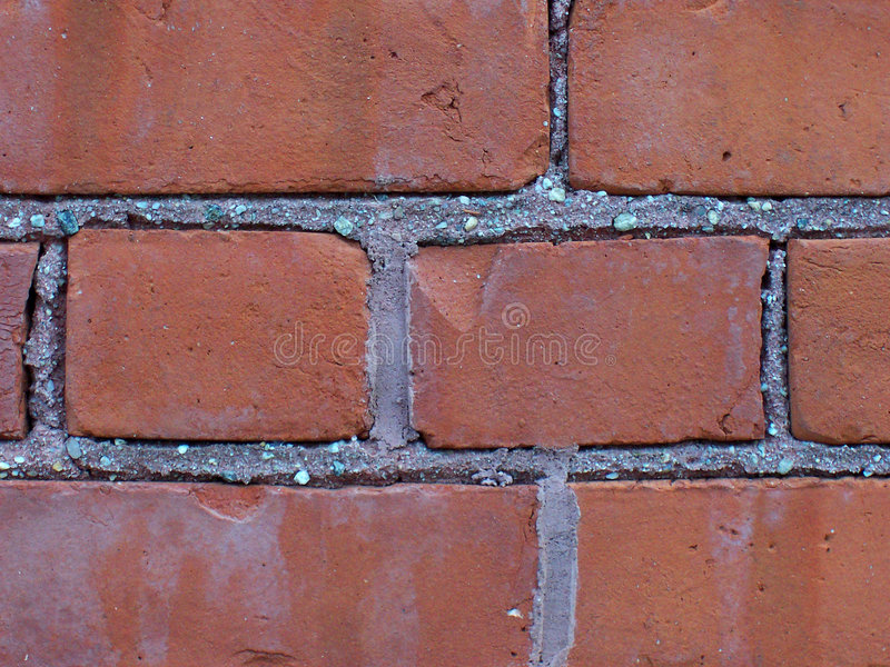 Bricks. Detail of a wall made with bricks and cemant stock image