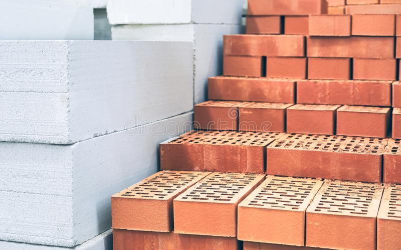 Bricks and aerated concrete blocks. White lightweight concrete block. Red brick. Building material.  stock images