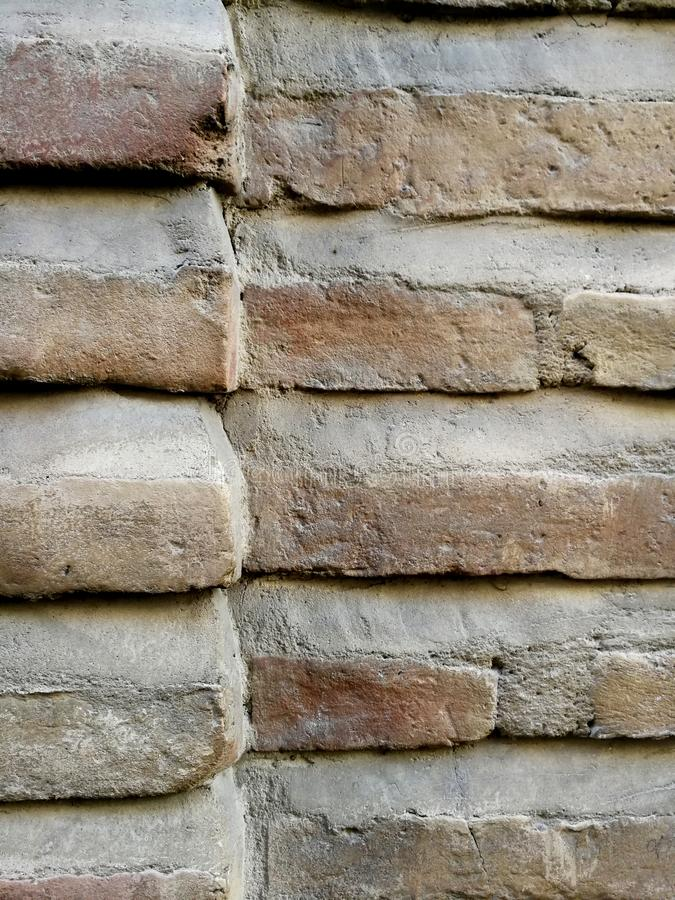 Bricks of an antique construction. Intersection and corner of a pillar stock images