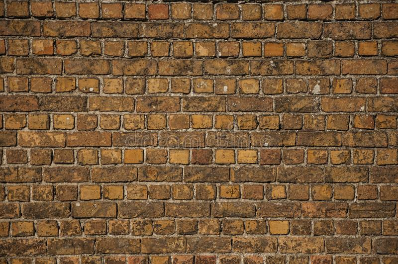 Bricks forming a background. Close-up of orange bricks forming a background, in the late afternoon light at Damme. A quiet and charming countryside old village stock photography