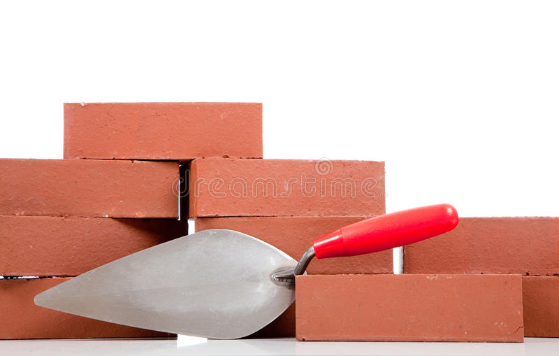 Bricks and a mason's trowel stock image