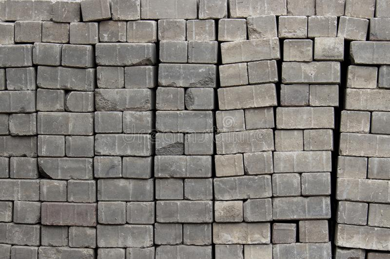 Bricks for paving stones stacked in stacks, background texture structure royalty free stock image