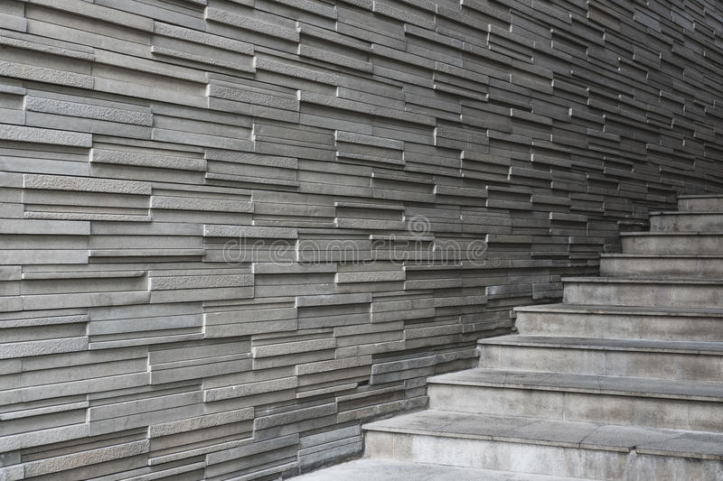 Bricks slate wall texture, with concrete cement stair steps stock photography