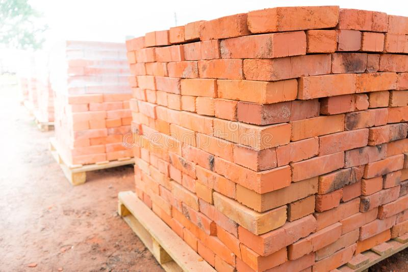 The bricks are stacked on wooden pallets and prepared for sale. Clay brick is an ecological building material.  stock images