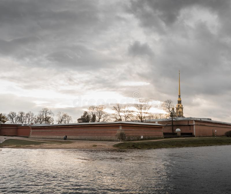 River Saint-Petersburg embankment historical building clouds day. Bricks wall Saint-Petersburg historical building church royalty free stock photo