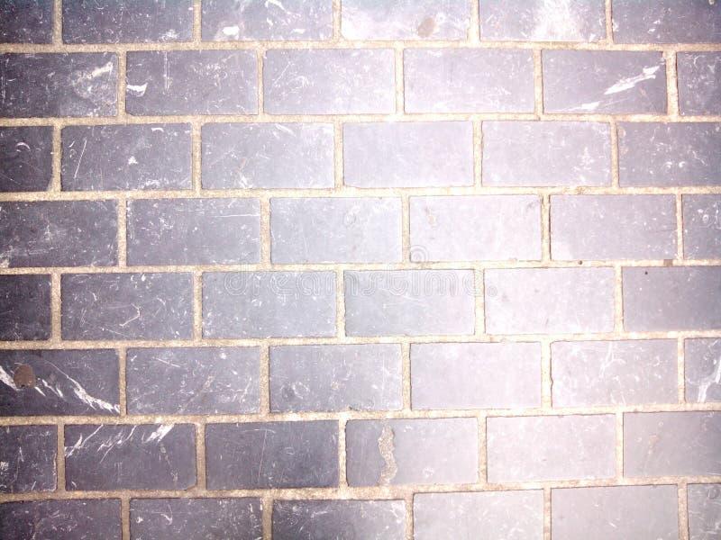 Bricks wall texture. Black and dirty bricks wall texture royalty free stock photos