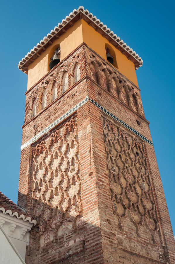 Brickwork on the bell tower of a village church stock photos
