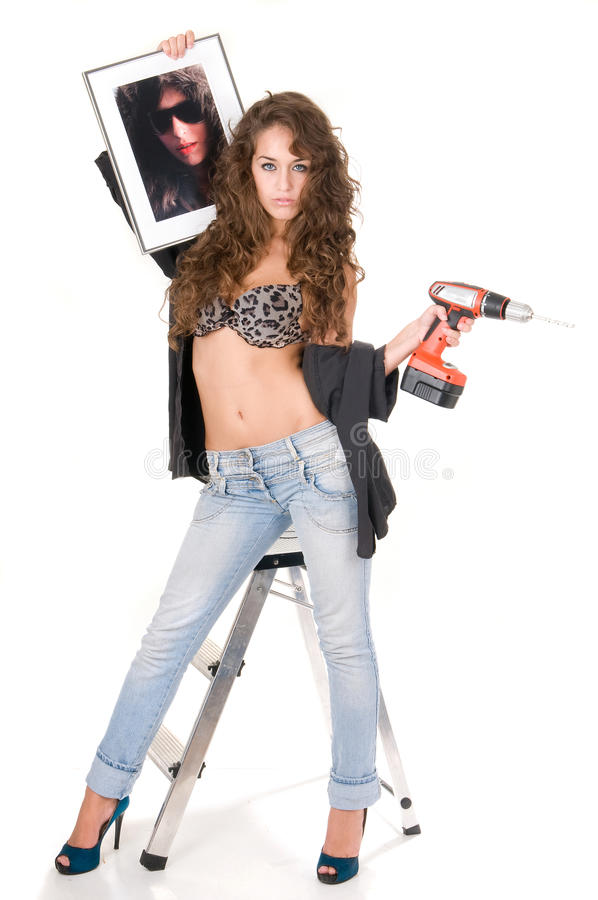 Bricolage woman with a picture to hung. In white royalty free stock images