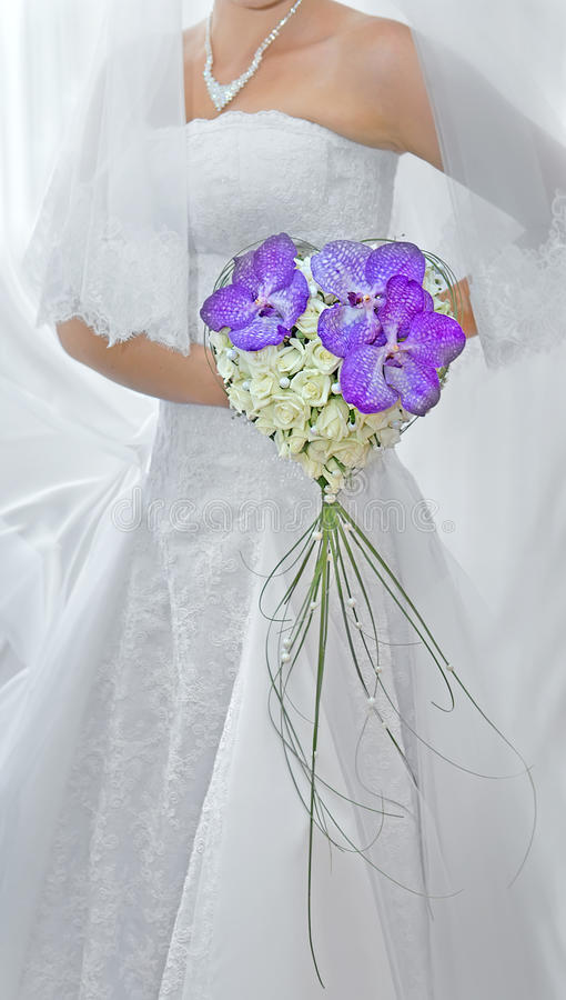 Bridal bouquet. Bride with a bouquet of flowers stock photography