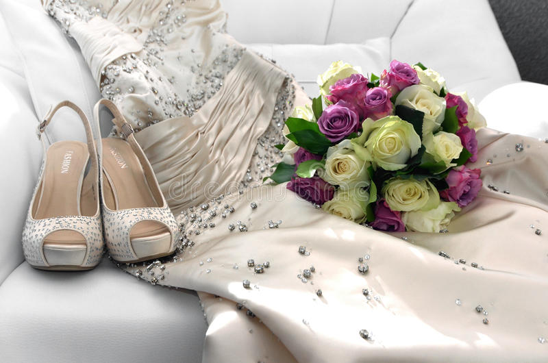 Bridal bouquet. Wedding fashion shoes and dress with bridal bouquet stock photo