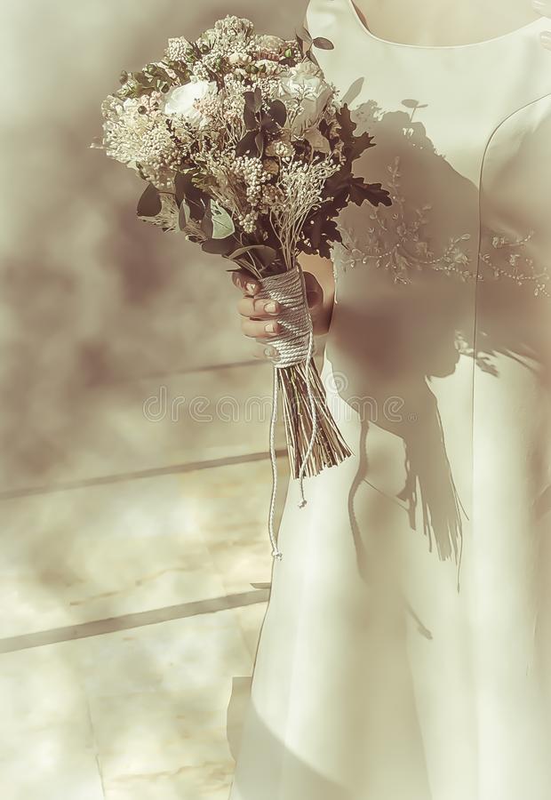Bridal bouquet caught with hands. Adult, attractive, background, beautiful, beauty, bride, celebration, decoration, dress, female, floral, flower, flowers royalty free stock photos