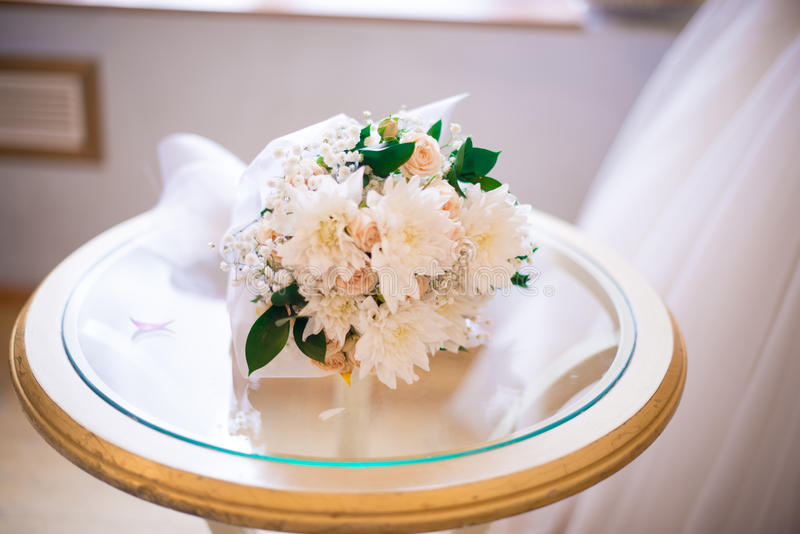 Bridal bouquet. On the foto you can see the delicate wedding bouquet and hemline bridesmaid dresses royalty free stock photos