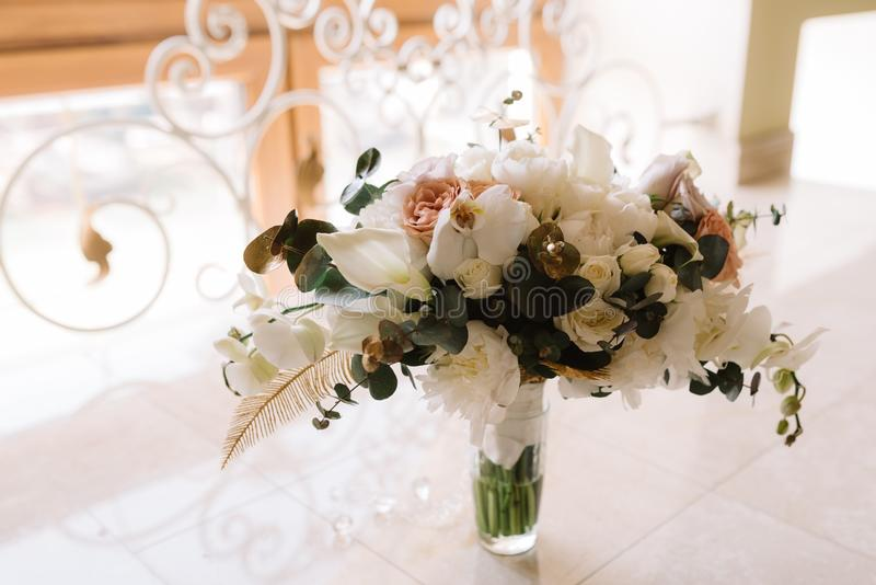 Bridal bouquet from gentle details and fresh flowers. A wedding bouquet from natural materials and flowers royalty free stock images