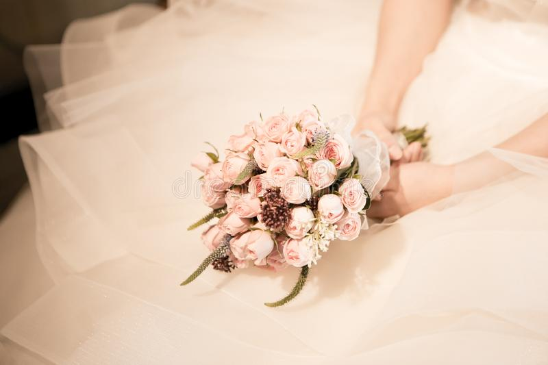 Bridal bouquet and gown