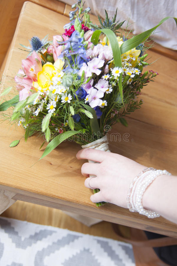 Bridal bouquet with hand of bride stock image