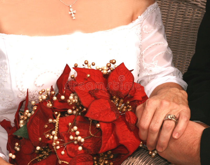 Bridal bouquet of red poinsettias royalty free stock image