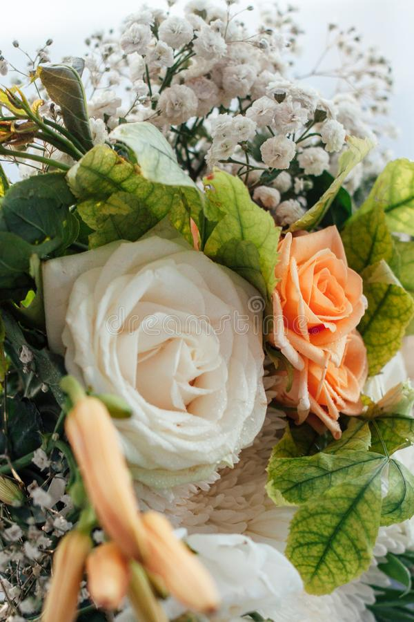 Bridal bouquet of roses and other flowers stock images