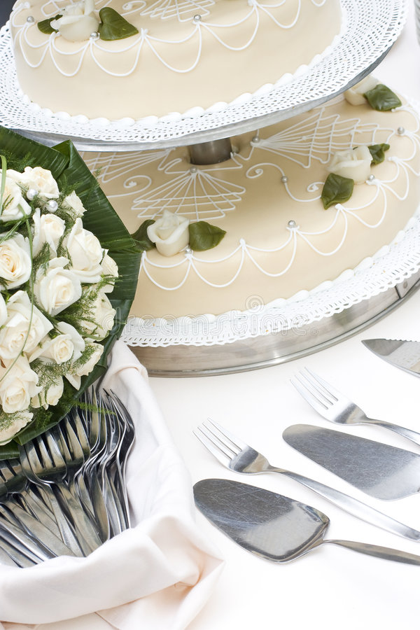 Bridal Bouquet And Wedding Cake Stock Photos