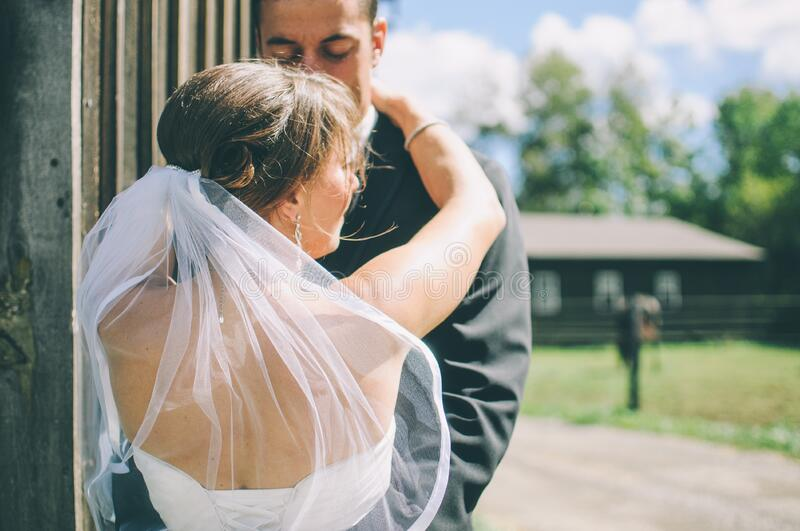 Bridal couple dancing outdoors royalty free stock image