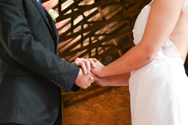 Bridal Couple holding hands stock images