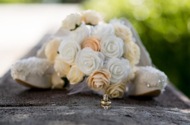 Bridal Bouquet and rings. Wedding icon. Bridal flower and rings. Wedding icon. Close-up. Wedding icon. Happiness. Jewelry. Bouquet stock photography