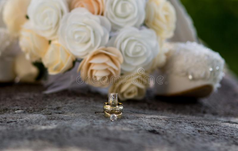Bridal Bouquet and rings. Wedding icon. Bridal flower and rings. Wedding icon. Close-up. Wedding icon. Happiness. Jewelry. Bouquet stock photos