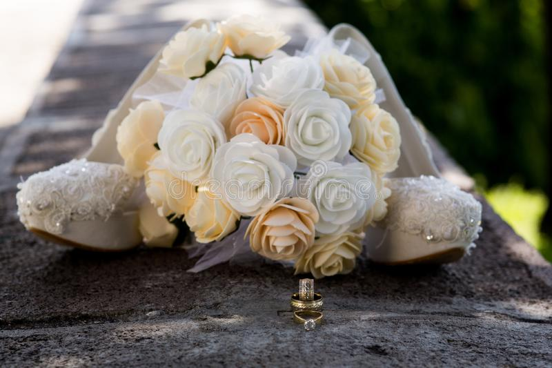 Bridal Bouquet and rings. Wedding icon. Bridal flower and rings. Wedding icon. Close-up. Wedding icon. Happiness. Jewelry. Bouquet stock image