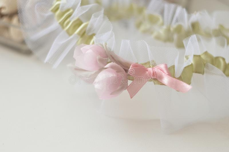 Bridal garter with silk flowers piones. Elegance wedding day celebration of love and marriage stock photos
