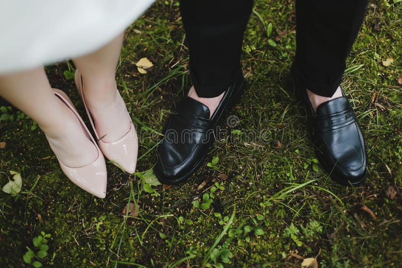 Bridal and groom wedding shoes on the background of green grass. wedding details, wedding day royalty free stock photos