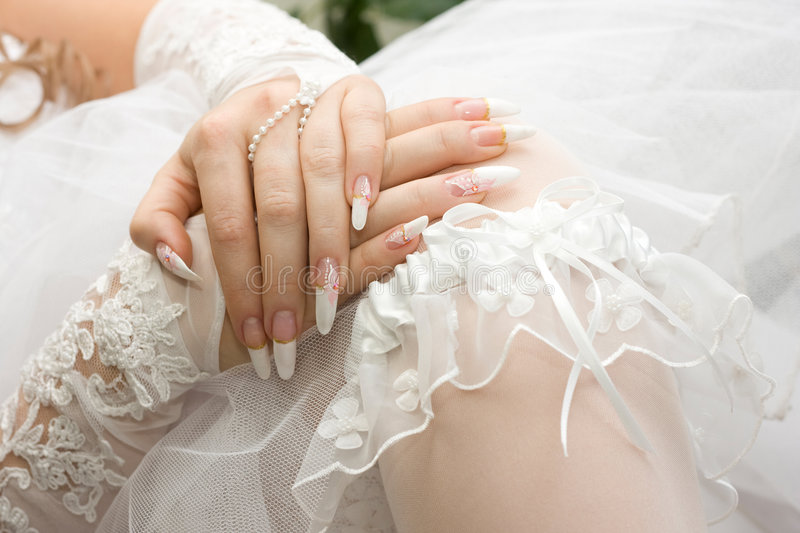Bridal manicure and garter. Beautiful bridal manicure and garter. Iso 200 royalty free stock photo