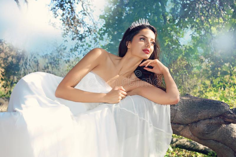 Bridal modeling. Beautiful engagement photoshoot in the forest stock photography