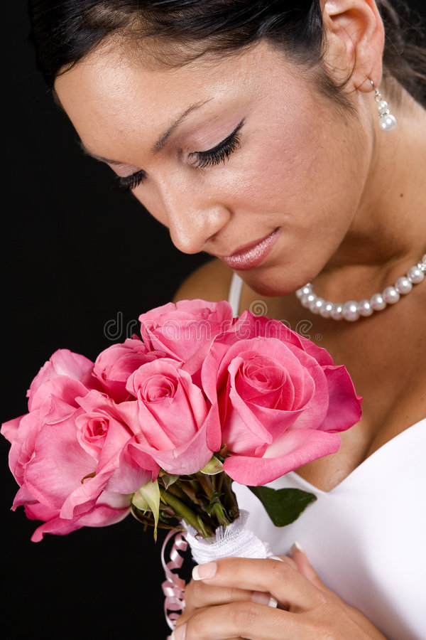 Bridal Portrait. Over black background with flowers royalty free stock photo