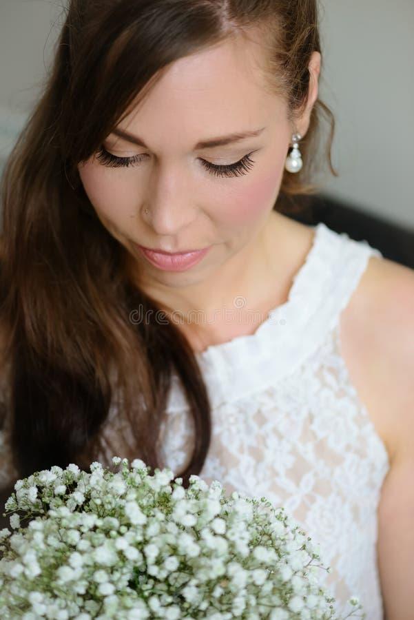 Bridal portrait of a white caucasian female looking down retro vintage lace dress stock photography