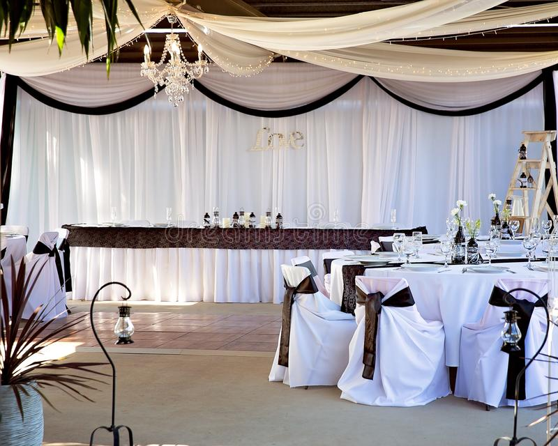 Bridal and reception tables set up for a wedding using a black and white colour scheme. Features softly draped and pleated fabric fairy lights ... & Wedding Reception Decor And Set Up Stock Image - Image of bridal ...