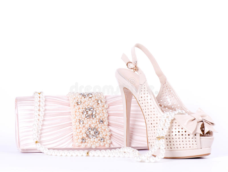 Bridal shoes, bag and beads. The beautiful bridal shoes, bag and beads royalty free stock image