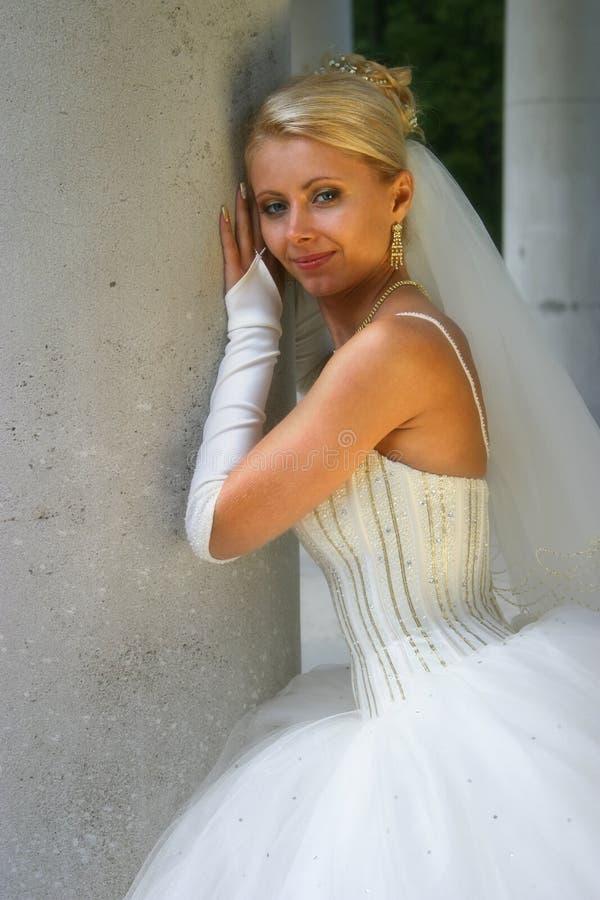Bride. The beautiful bride at a column stock image