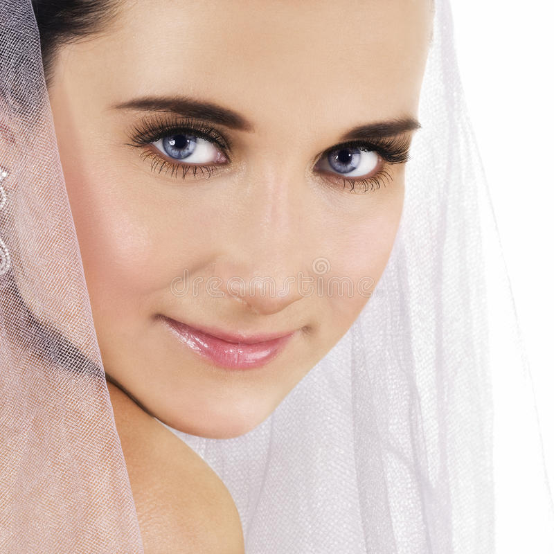 Bride. Portrait of beautiful bride in white veil royalty free stock images