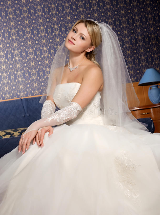 Bride. Beautiful and happy bride in a wedding dress stock photo