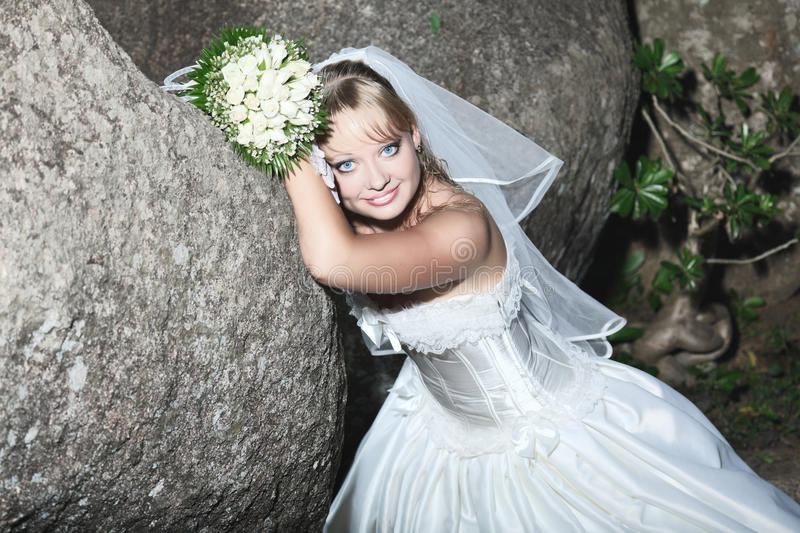 Download Bride stock photo. Image of gloves, stone, bouquet, cute - 16565174