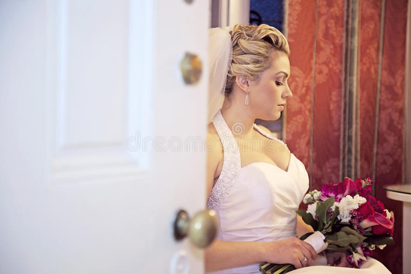 Bride waiting behind door royalty free stock photos