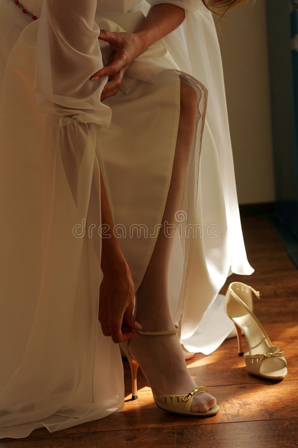 Download Bride adjusting her Shoes stock photo. Image of woman - 3102272