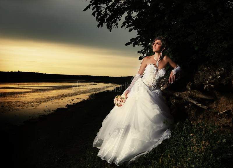 Download Bride Admiring The Sunset Stock Photo - Image: 28050560