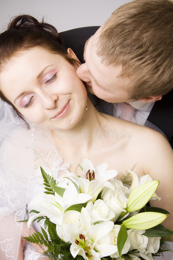 Free Bride And Groom Kissing Stock Image - 7695721