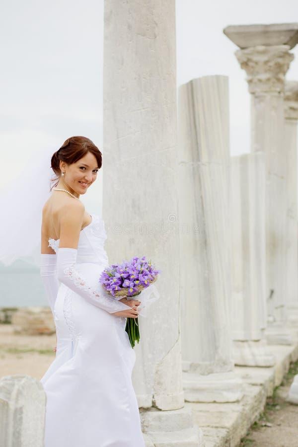 Bride among antique architecture stock images