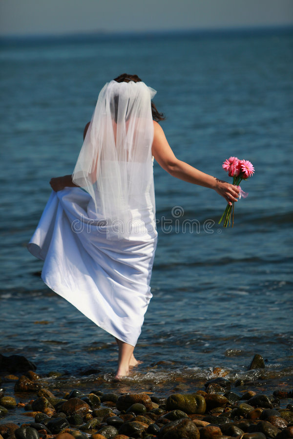 Download Bride Barefoot In Water Royalty Free Stock Photography - Image: 9173157