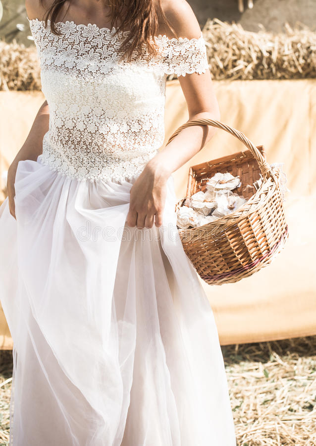 The bride with a basket in hands stock photo