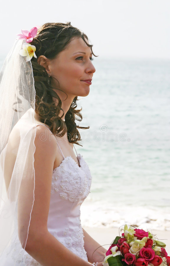 Bride on Beach with Bouquet royalty free stock image