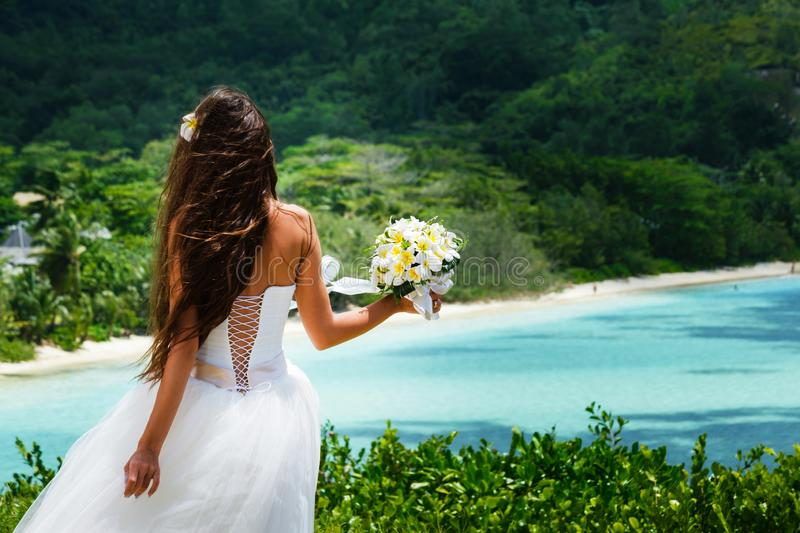Bride in a white wedding dress with bouquet royalty free stock image