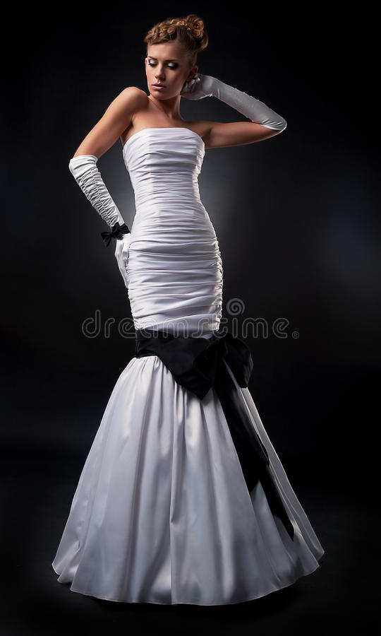 Bride blonde in white wedding dress and gloves royalty free stock image