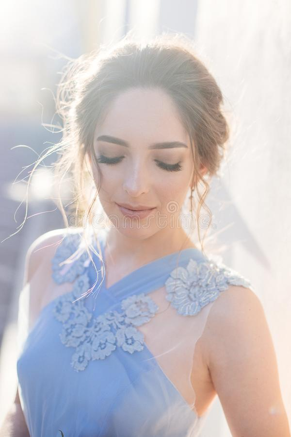Bride in blue dress. Beautiful bride girl in a blue dress with long hair at sunset royalty free stock images